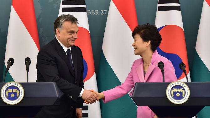 Hungarian Prime Minister Orban shakes hands with South Korean President Park after a joint news conference at the presidential Blue House in Seoul