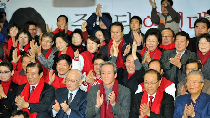 Party leaders and members of South Korean presidential candidate Park Geun-Hye's ruling Saenuri Party  watch a television broadcasting  exit polls at the party's headquarters in Seoul on Wednesday, Dec. 19, 2012. Surveys released after polls closed in South Korea's hard-fought presidential election Wednesday indicated the race to replace unpopular incumbent Lee Myung-bak was too close to call. (AP Photo/Kim Jae-hwan, Pool)