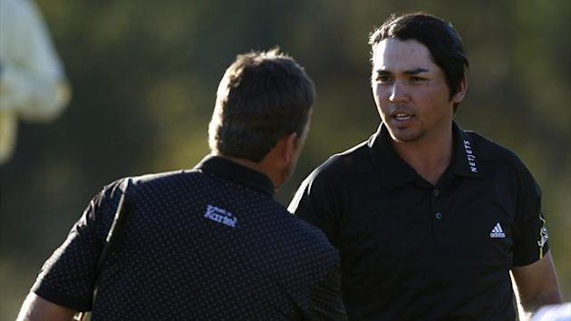 Jason Day (R) of Australia shakes hands with Graeme McDowell of Northern Ireland after their quarterfinal round match of the WGC-Accenture Match Play Championship golf tournament in Marana, Arizona (Reuters)