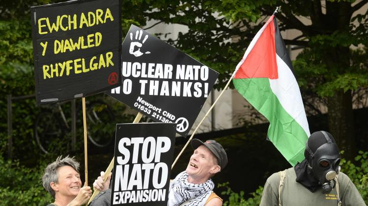 Protesters gather at Newport Civic Centre before an anti-war protest march in Newport, Wales