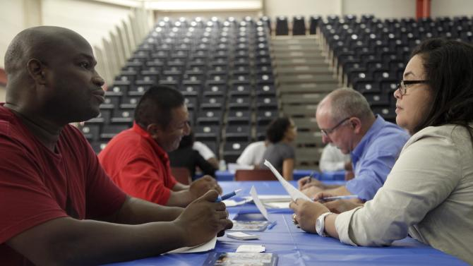 FILE - In this Tuesday, Aug. 21, 2012 file photo, job seekers fill out applications at a construction job fair in New York. The Labor Department said Friday, Sept. 21, 2012, that unemployment rates rose in 26 states last month, the latest evidence that hiring remains tepid across the country. (AP Photo/Seth Wenig, File)