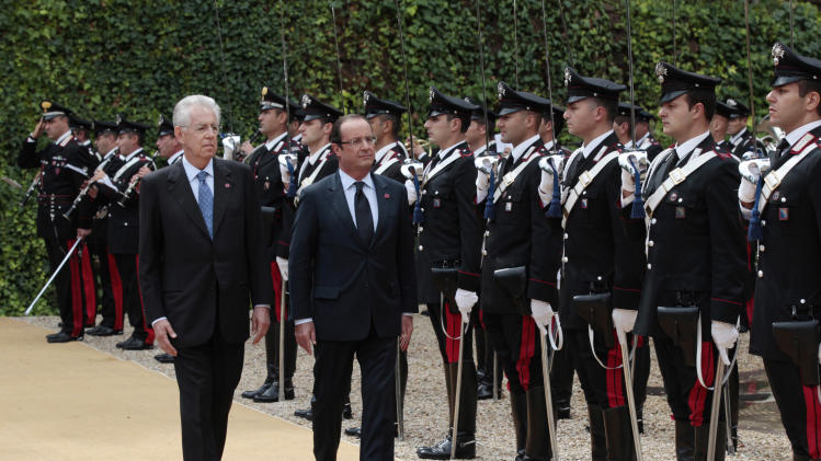 French President Francois Hollande, center, and Italian Premier Mario Monti, left, arrive for a bilateral meeting at Villa Madama in Rome, Tuesday, Sept. 4, 2012. (AP Photo/Gregorio Borgia)