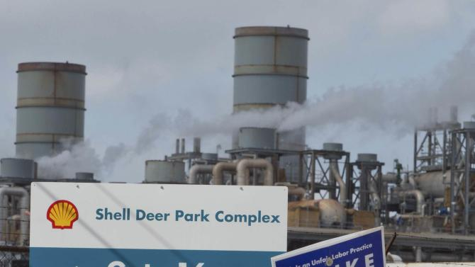 Workers from the USW union walk a picket line outside the Shell Oil Deer Park Refinery in Deer Park, Texas
