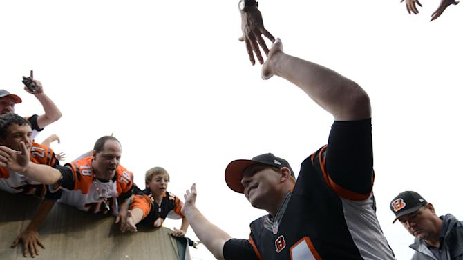 Cincinnati Bengals quarterback Andy Dalton leaves the field after his team defeated the New York Giants 31-13 in an NFL football game on Sunday, Nov. 11, 2012, in Cincinnati. (AP Photo/Michael Keating)