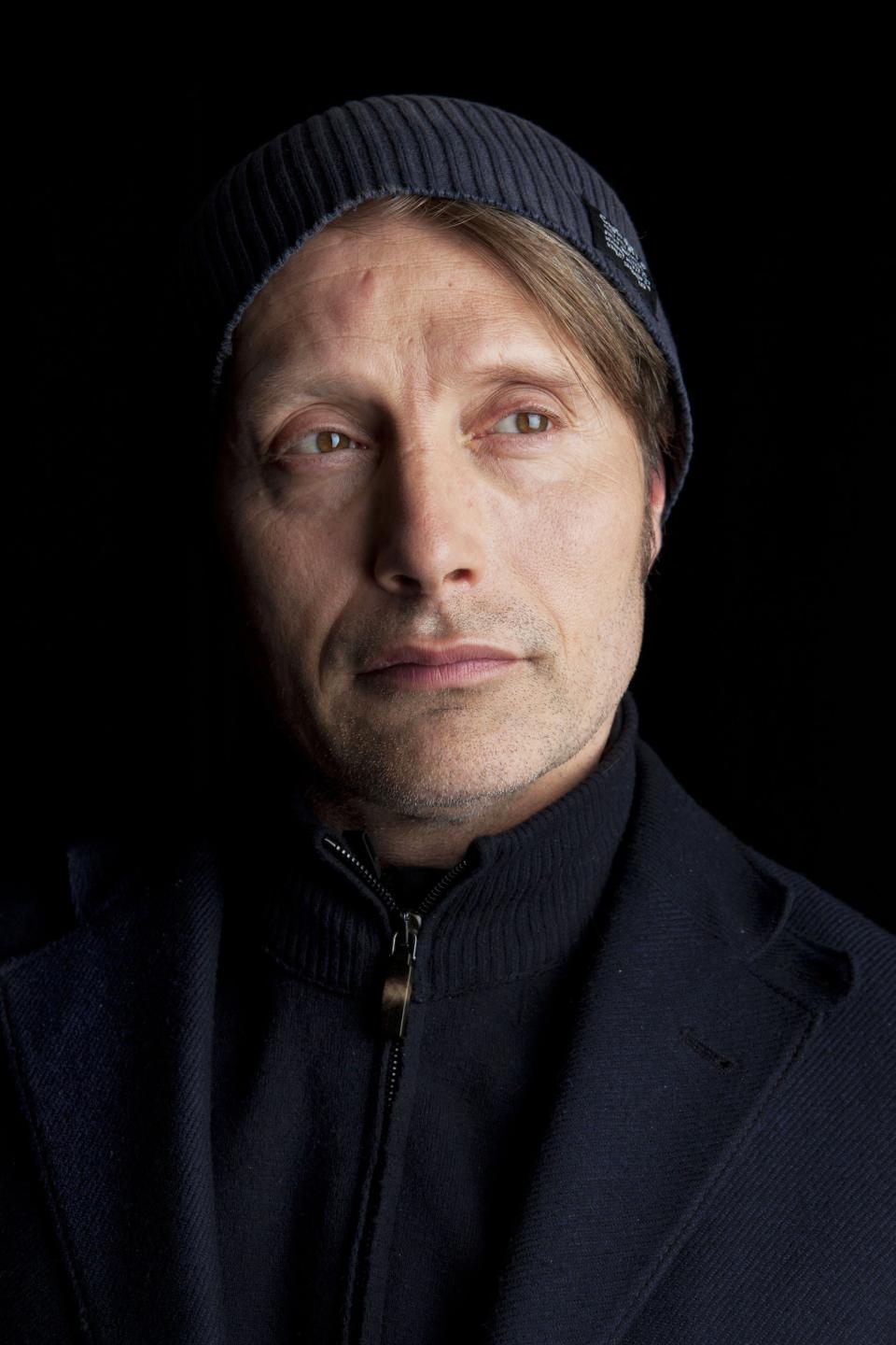 "This March 21, 2013 photo shows Danish actor Mads Mikkelsen poses for a portrait in New York.  Mikkelsen stars as Dr. Hannibal Lecter in the new series ""Hannibal,"" premiering Thursday, April 4, at 10 p.m. on NBC. (Photo by Amy Sussman/Invision/AP)"