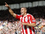 Stoke City's striker Jonathan Walters celebrates scoring during a match in 2011. Wigan Athletic and Stoke City played out an entertaining 2-2 draw in the sun at the DW Stadium on Saturday as the visitors twice came from behind to earn a point