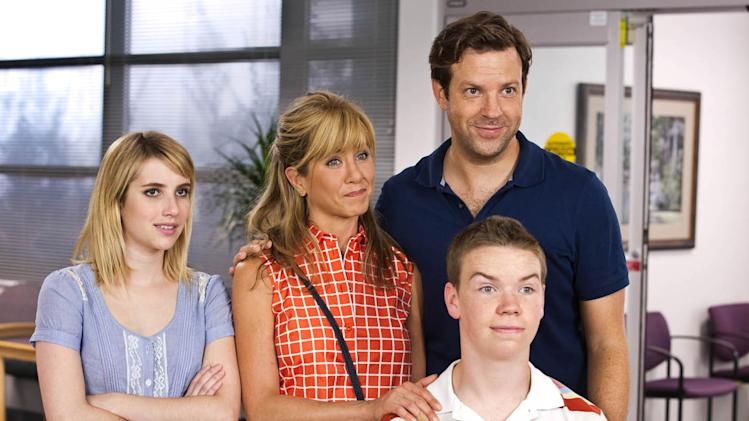 "This film image released by Warner Bros. Entertainment shows, from left, Emma Roberts, Jennifer Aniston, Jason Sudeikis, background right, and Will Poulter in a scene from ""We're the Millers."" (AP Photo/Warner Bros. Entertainment, Michael Tackett)"