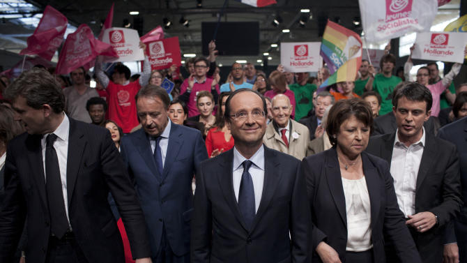 French Socialist Party candidate for the 2012 presidential elections Francois Hollande, center,  Arnaud Montebourg, left, President of the Senate Assembly, Jean Pierre Bel, second from left, Socialist Party leader, Martine Aubry, second from right, and Manuel Valls, right, attend  a nomination ceremony, in Paris, Saturday Oct. 22, 2011. (AP Photo/Thibault Camus)