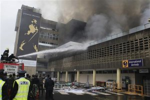 Fire fighters struggle to put out a fire at the Jomo …