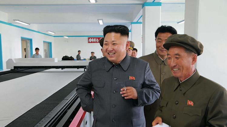 North Korean leader Kim Jong Un gives field guidance at the October 8 Factory