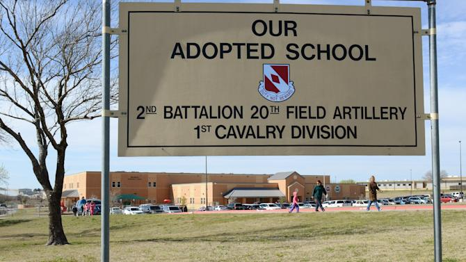 In this Feb. 22, 2013 photo provided by the Killeen Independent School District, a sign indicates that Meadows Elementary School is the adopted school of the U.S. Army's 20th Field Artillery Unit, First Calvary Division in Fort Hood, Texas. Meadows is one of nine public schools on Fort Hood operated by Killeen Independent School District, which stands to lose at least $2.6 million before the end of the year if across-the-board federal spending cuts take effect. (AP Photo/Killeen Independent School District, Todd Martin)