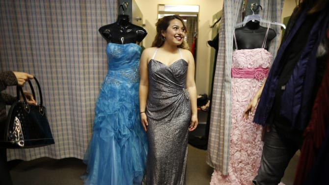 Puentes tries on a dress at an event that provides free prom dresses, shoes and accessories to 70 homeless and low income school girls from the Assistance League of Los Angeles in Los Angeles