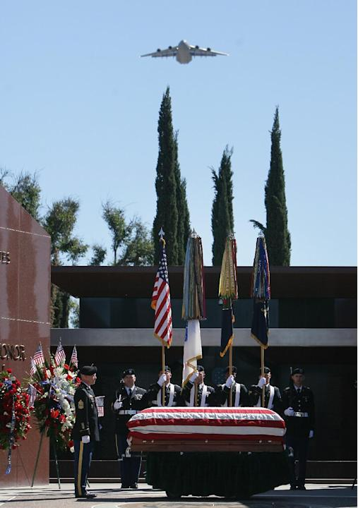 A flyover is performed during the memorial service for Walter Ehlers outside the Medal of Honor Memorial at the Riverside National Cemetery on Saturday, March 8, 2014. (AP Photo/The Press-Enterprise,