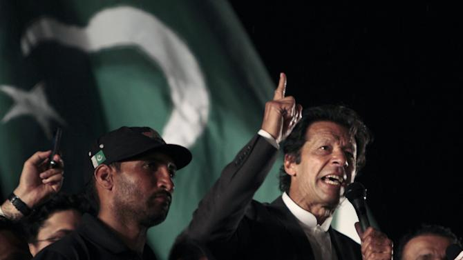 Pakistani cricket legend-turned politician Imran Khan addresses at a rally in Lahore, Pakistan on Saturday, March 23, 2013.  Khan rallied around 100,000 flag-waving supporters in the eastern city of Lahore on Saturday ahead of a historic national election later this spring. (AP Photo/K.M. Chaudary)