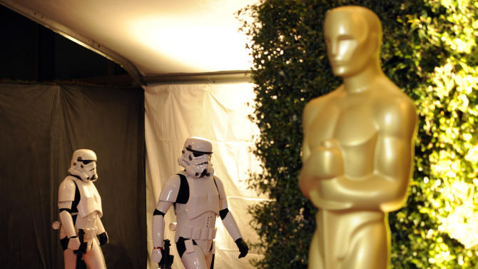 """Actors dressed as """"Stormtroopers"""" from the """"Star Wars"""" franchise arrive as presenters at the Academy of Motion Picture Arts and Sciences' 2011 Governors Awards, Saturday, Nov. 12, 2011, in Los Angeles. The Governors Awards is an annual event celebrating awards conferred by the Academy's Board of Governors, with highlights being incorporated into next year's Academy Awards show. (AP Photo/Chris Pizzello)"""