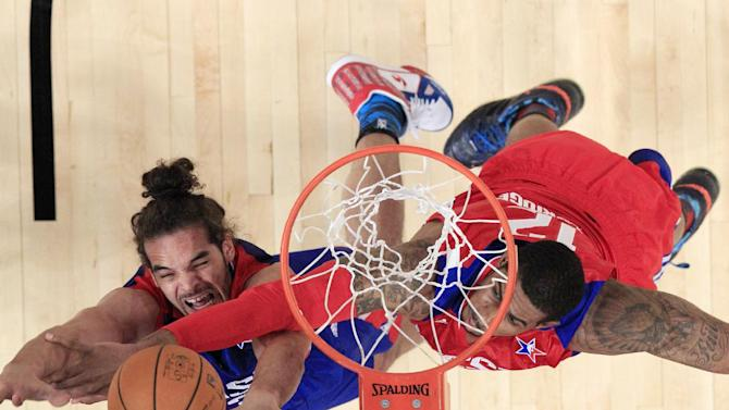 East Team's Joakim Noah from France, of the Chicago Bulls, left, is fouled by West Team's LaMarcus Aldridge of the Portland Trail Blazers crash the boards during the first half of the NBA All-Star basketball game Sunday, Feb. 17, 2013, in Houston. (AP Photo/Lucy Nicholson, Pool)