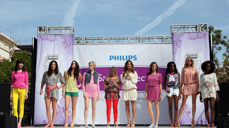 Models rocked Spring trends down the catwalk at the Philips Satin Perfect fashion and beauty event hosted by brand ambassador, Alessandra Ambrosio, styled by Inge Fonteyne on Friday, March 23, 2012 in Los Angeles. (Casey Rodgers/AP Images for Philips)
