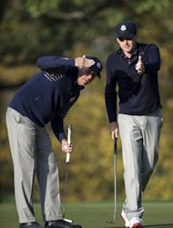 Team USA&#39;s Phil Mickelson (L) and Keegan Bradley line up a put on the 3rd hole&#39;s green during the morning four ball match on the second day of the 39th Ryder Cup at the Medinah Country Club in Illinois. The United States maintained a stranglehold on the 39th Ryder Cup on Saturday winning the foursomes and sharing the fourballs to leave Europe trailing 10-6 at the end of the day
