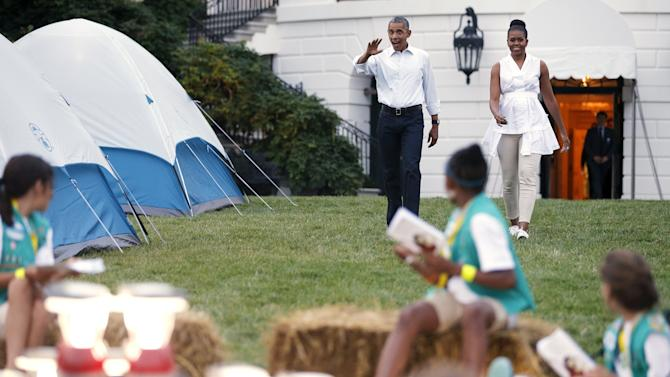 Barack and Michelle Obama arrive to greet Girl Scouts camping out on South Lawn of White House in Washington
