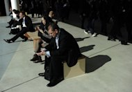 A man checks a mobile phone at the 2013 Mobile World Congress in Barcelona on February 26, 2013. Several smartphones now offer applications that link with diagnostic tools, for example to perform urine analysis or check the blood sugar levels of people with diabetes