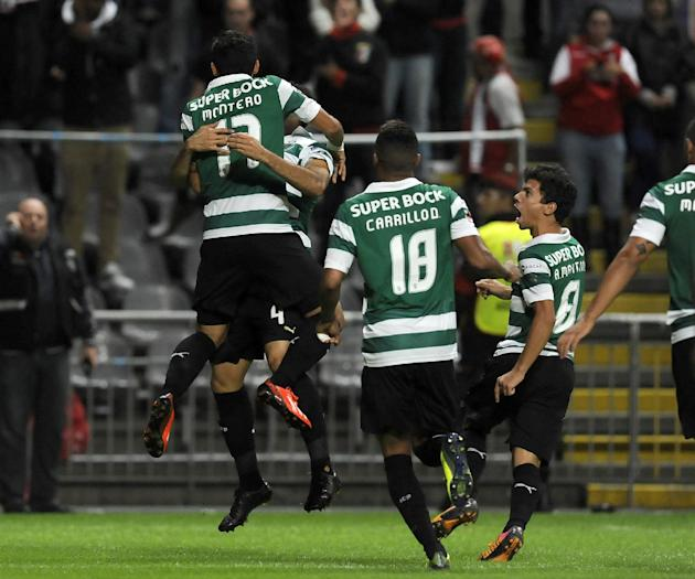 Sporting's Fredy Montero, left, from Colombia, celebrates with teammates after scoring against Sporting Braga during their Portuguese League soccer match at the Municipal Stadium, in Braga, Portugal,