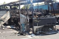 The wreckage of a bus in Burgas after an explosion ripped through it on July 18, injuring more than 30 Israelis and killing six people. Bulgarian police on Wednesday released a composite picture of the man they believe was the suicide bomber who launched the attack