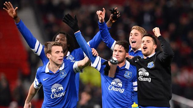 Everton players celebrate after their win over Manchester United (AFP)