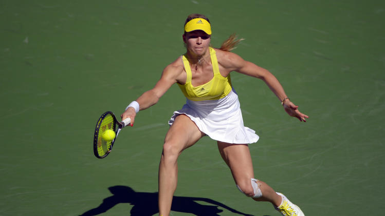 Maria Kirilenko, of Russia, returns a shot against Petra Kvitova, of the Czech Republic, during their match at the BNP Paribas Open tennis tournament on Wednesday, March 13, 2013, in Indian Wells, Calif. (AP Photo/Mark J. Terrill)