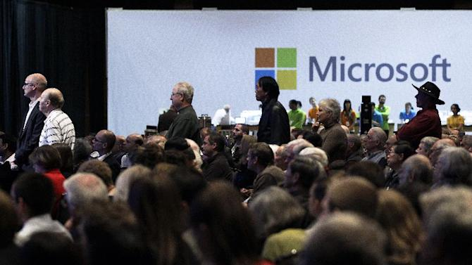 Microsoft Corp. shareholders wait in line to ask questions during Microsoft's annual meeting of shareholders, Wednesday, Nov. 28, 2012, in Bellevue, Wash. (AP Photo/Ted S. Warren)