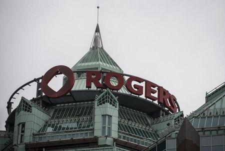 A Rogers sign is seen at its headquarters following the Rogers Communications Inc AGM in Toronto
