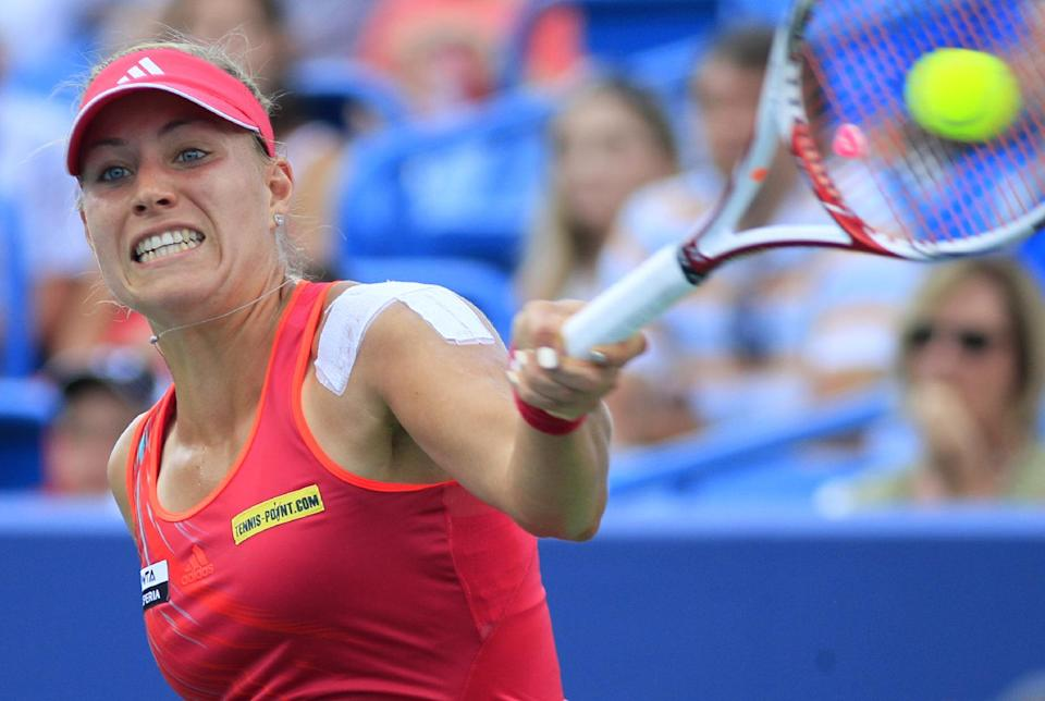 Angelique Kerber, of Germany, hits a forehand against Li Na, from China, during the women's final at the Western & Southern Open tennis tournament, Sunday, Aug. 19, 2012, in Mason, Ohio. (AP Photo/Al Behrman)