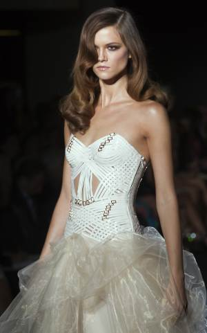 A model wears a creation by fashion designer Donatella Versace during her Women's Fall Winter 2013 haute couture fashion collection, for fashion house in Paris, France, Sunday, July 1, 2012. (AP Photo/Jacques Brinon)