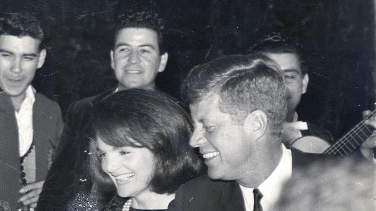 In this black-and-white image provided by Alexander Arroyos, taken on Nov. 21, 1963, shows President John F. Kennedy and first lady Jacqueline Kennedy greeting Latino activists at a LULAC gala in Houston's Rice Hotel. Historians say Kennedy's appearance at the Rice Ballroom _ 49 years ago this week and the night before his assassination _ was likely the first time a U.S. president officially acknowledged Latinos as an important voting block.  (AP Photo/Courtesy of Alexander Arroyos)