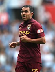 Yaya Toure is please Carlos Tevez, pictured, is back at Manchester City