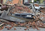 In this photo taken Friday, June 29, 2012 shows a brick wall from the second story of the Christie's on the Square store in Columbus Grove, Ohio. The bricks fell on and crushed two vehicles as strong winds tore through the region Friday afternoon. (AP Photo/The Lima News, Jay Sowers)