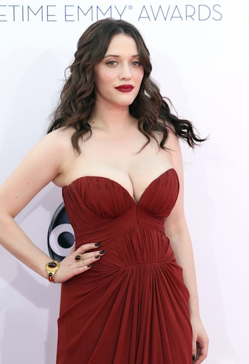 Kat Dennings arrives at the 64th Primetime Emmy Awards at the Nokia Theatre on Sunday, Sept. 23, 2012, in Los Angeles. (Photo by Matt Sayles/Invision/AP)