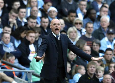 Wigan Athletic manager Rosler reacts during their English FA Cup quarter final soccer match against Manchester City at the Etihad stadium in Manchester