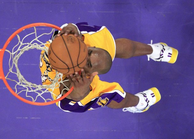 Los Angeles Lakers Bryant slam dunks against the Toronto Raptors during NBA game in Los Angeles