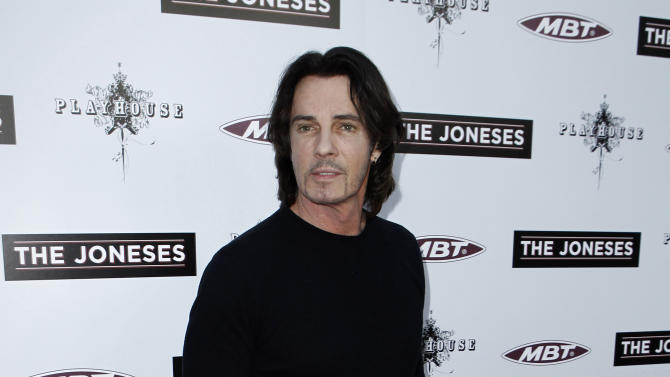 """FILE - In this April 8, 2010 file photo, musician Rick Springfield arrives at the premiere of """"The Joneses"""" in Los Angeles. Springfield's attorney entered a no contest plea Thursday, Aug. 9, 2012, to a misdemeanor count of reckless driving with driving under the influence conditions and received a three year informal probation sentence. Springfield was arrested in May 2011 after a deputy spotted him speeding on the Pacific Coast Highway in Malibu, Calif. (AP Photo/Matt Sayles, File)"""
