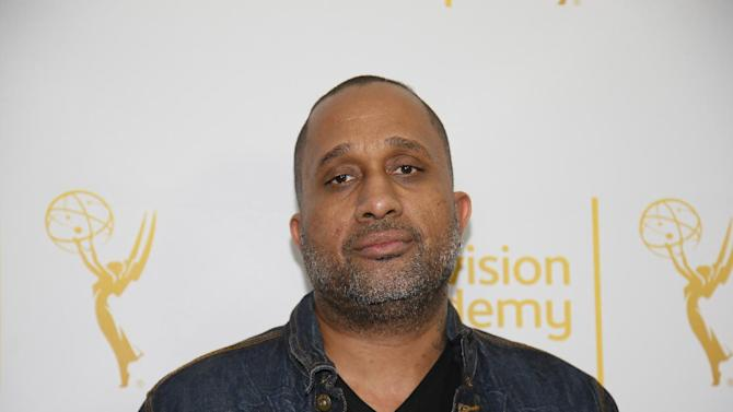 """FILE - In this Jan. 28, 2015 file photo, Creator and Executive producer of """"Black-ish,"""" Kenya Barris, poses on the red carpet at """"An Evening with Norman Lear,"""" presented by the Television Academy at the Montalban Theatre in the Hollywood section of Los Angeles. Barris is set to write the screenplay for a """"Good Times"""" film based on the hit '70s sitcom, his manager confirmed Monday, April 26, 2015, to The Associated Press. """"Good Times,"""" which aired on CBS from 1974 to 1979, was about an African-American family living in a poor neighborhood in Chicago. (Danny Moloshok/Television Academy via AP, File)"""