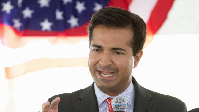 In this photo taken July 6, 2015, Rep. Carlos Curbelo, R-Fla. speaks in Miami. Curbelo has been diagnosed with whooping cough, a rare and contagious disease that's officially known as pertussis. (AP Photo/Wilfredo Lee)
