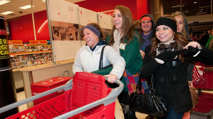 Shoppers eager for doorbuster deals enter the Roseville, Minn. Target store Thursday Nov. 22, 2012 for Black Friday shopping. (Dawn Villella/AP Images for Target)