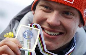 Germany's Loch presents his gold medal after winning the FIL Luge World Championships in Altenberg