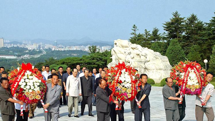 In this photo released by Korean Central News Agency and distributed by Korea News Service in Tokyo, Kim Yong Nam, the head of the North's parliament, in a white jacket at center left, and other leaders arrive at the revolutionary martyrs' cemetery to offer flowers in Pyongyang, North Korea on Wednesday, July 27, 2011, which marks the 58th anniversary of the cease-fire of the 1950-53 Korean War. (AP Photo/Korean Central News Agency via Korea News Service) JAPAN OUT UNTIL 14 DAYS AFTER THE DAY OF TRANSMISSION