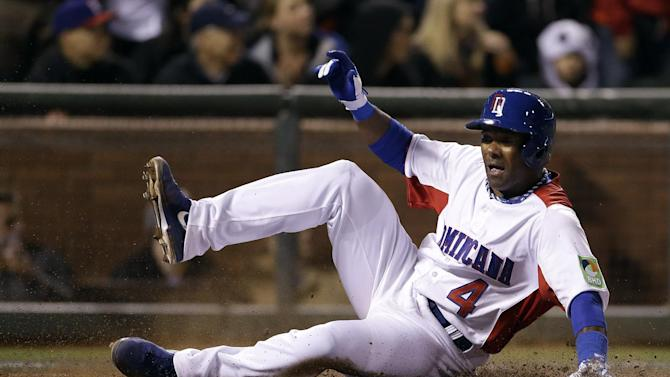 The Dominican Republic's Miguel Tejada (4) scores against the Netherlands during the fifth inning of a semifinal game of the World Baseball Classic in San Francisco, Monday, March 18, 2013. (AP Photo/Eric Risberg)