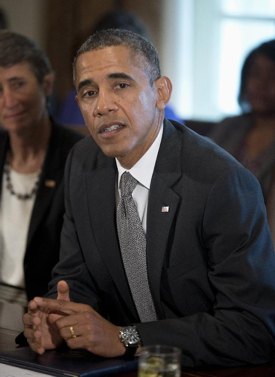 President Barack Obama speaks to members of the media before a cabinet meeting, Thursday, Sept. 12, 2013, in the Cabinet Room of the White House in Washington, Interior Secretary Sally Jewell is at left. (AP Photo/Pablo Martinez Monsivais)