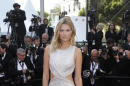 Model Toni Garrn poses for photographers upon arrival for the screening of the film The Little Prince at the 68th international film festival, Cannes, southern France, Friday, May 22, 2015. (Photo by Joel Ryan/Invision/AP)