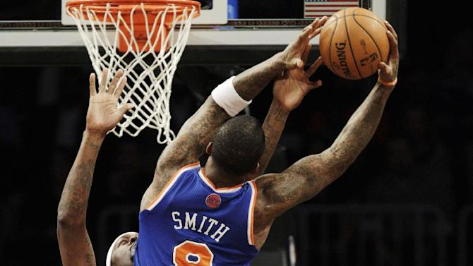 New York Knicks guard J.R. Smith (8) shoots over Brooklyn Nets forward Andray Blatche (0) in the first half of their NBA basketball game at Barclays Center, Monday, Nov. 26, 2012, in New York. (AP Photo/Kathy Willens)