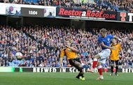 Dean Shiels scores the Rangers opener at Ibrox