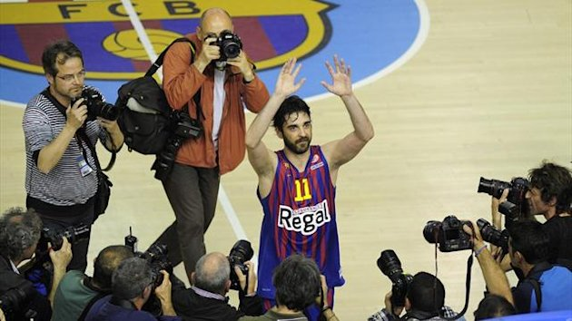 Regal Barcelona's guard Juan Carlos Navarro celebrates their victory and qualification for the Final Four at the end of their Euroleague play-off against Panathinaikos (AFP)